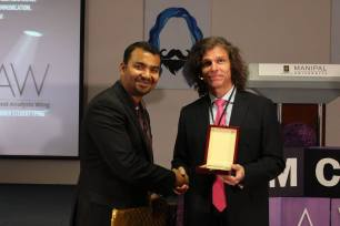 Chairperson of School of Media & Communication, Sabir Haque presents memento to Dr. Konrad Gunesch.