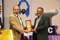 Dr. Firdos Alam Khan, Head of the Research & Development Committee at Manipal University Dubai and Chairperson of Life Sciences presents a momento to express our gratitude along with a special gift from the School of Media & Communication to #MCRAW2016 Keynote speaker, Professor K. Hariharan.